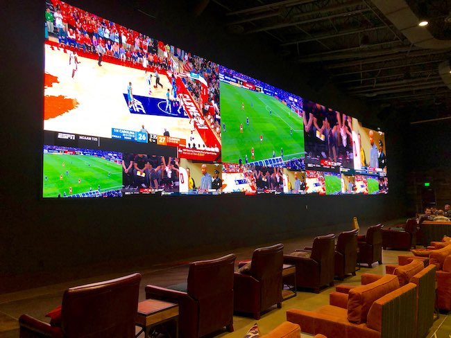 Mountain Pass Sports Bar with a 75-foot TV. Photo by Claudia Carbone