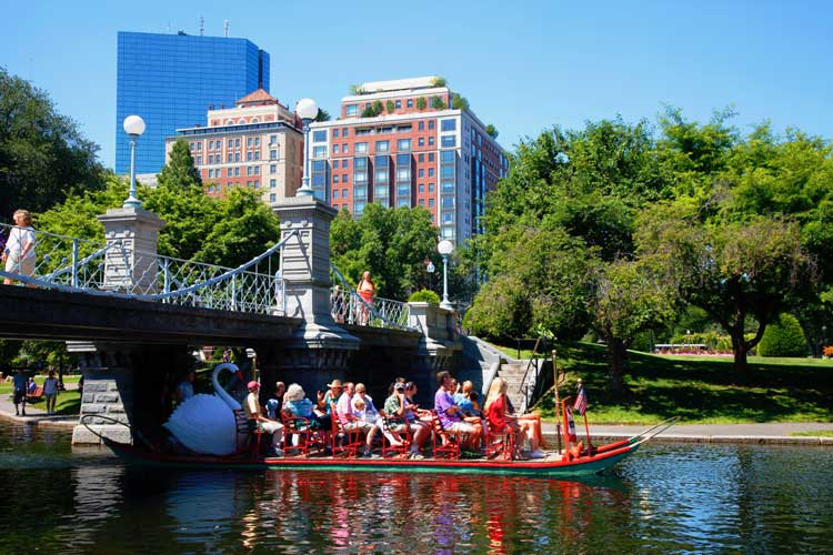 Swan pedal boats are a popular summer attraction in Boston Public Garden. Photo by Greater Boston CVB