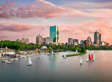 While traveling in Boston, we see sail boats catch the breeze on the Charles River against the Back Bay skyline. Photo by Kyle Klein