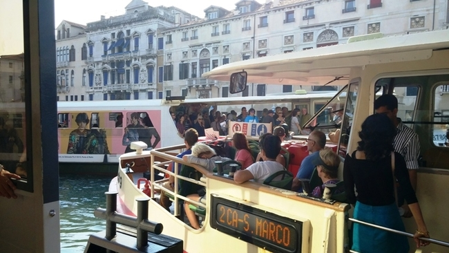 VAPORETTO BUS TRANSPORTS TOURISTS AND RESIDENTS ACROSS THE CANALS. PHOTO BY FYLLIS HOCKMAN