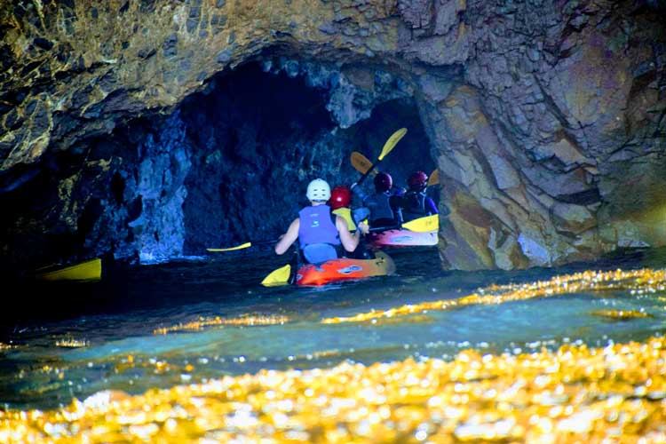 Exploring caves by kayak on Santa Cruz Island