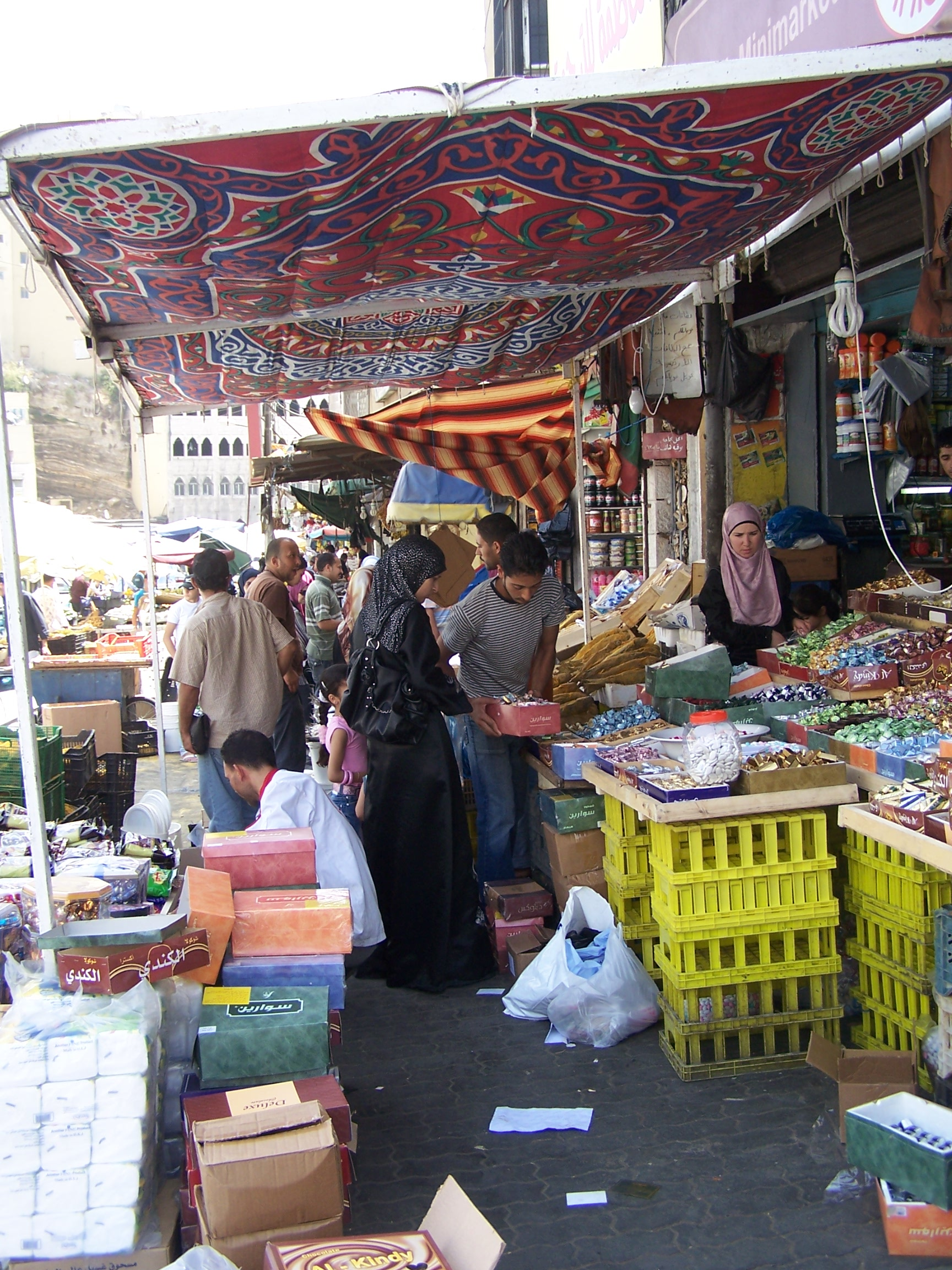 Shoppers at an outdoor market in Amman, Jordan, searched for items for the feast of Eid-u-Fitr, to celebrate the end of Ramadan. Photo by Carol.