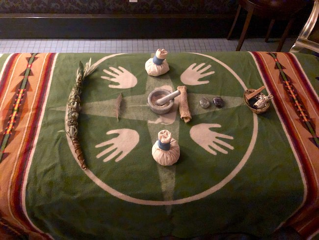 A treatment table set up for indigenous-inspired rituals. Photo by Claudia Carbone
