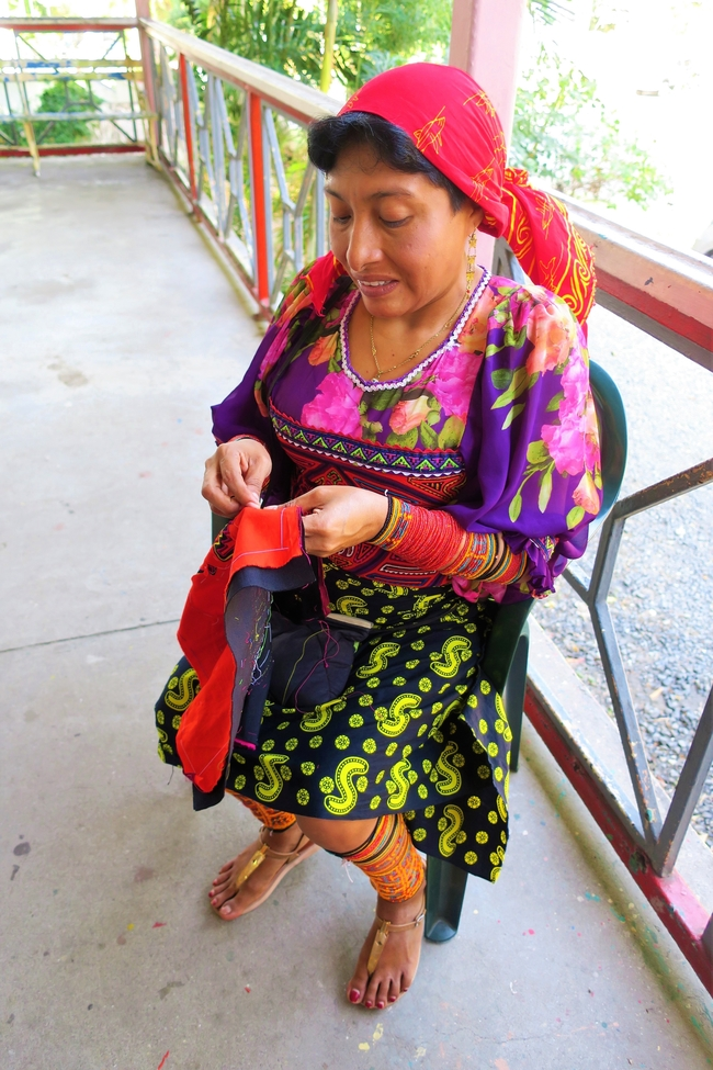 A Kuna woman embroidering a Mola. Photo by Victor Block
