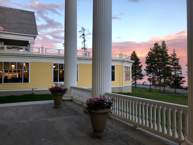 Lake Yellowstone Hotel veranda at sunset. Photo by Claudia Carbone