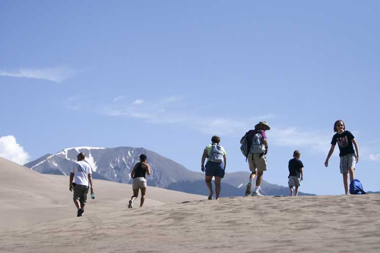 Hiking in the Great Sand Dunes in Colorado. Photo by Matt Inden/Miles