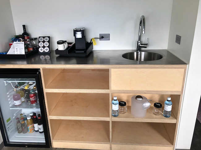 Mini bar and coffee maker. Photo by Claudia Carbone