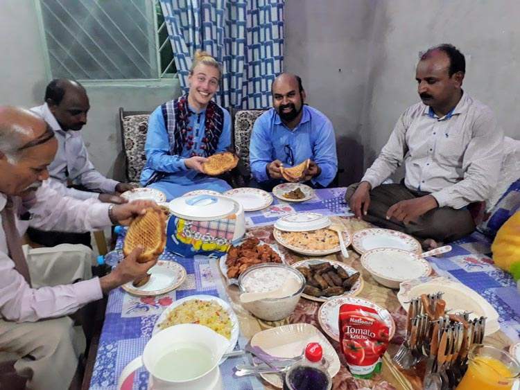 Dining on the bed in Pakistan.