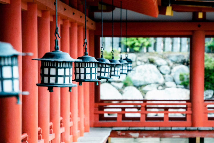 Row of lanterns hanging on a building on Itsukushima Island