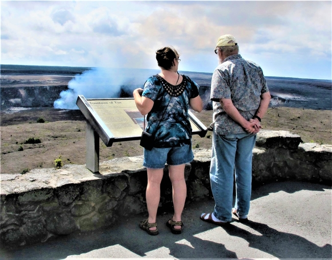 Visitors View a Volcano in Hawaii Volcanoes National Park on Hawaii Island. Photo by Victor Block