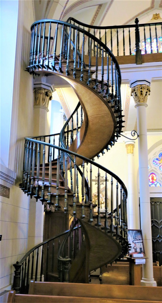 The Storied Staircase in the Loretto Chapel in Santa Fe, NM Weaves a Wonderful Tale. Photo by Victor Block
