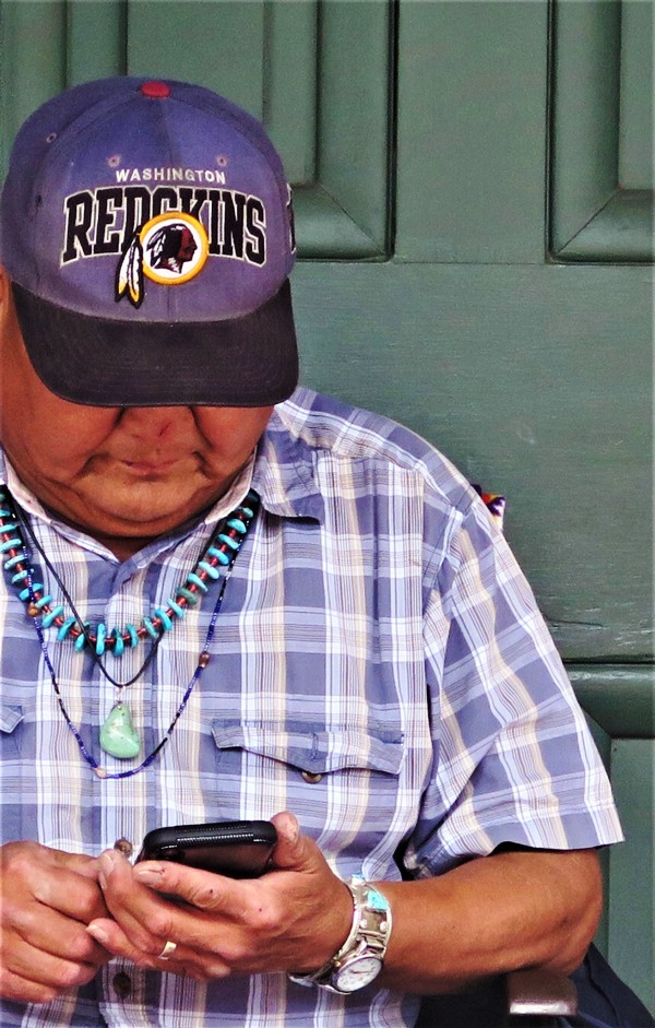 "A Native American Native of Santa Fe, NM Celebrates his ""Redskin"" Heritage. Photo by Victor Block"