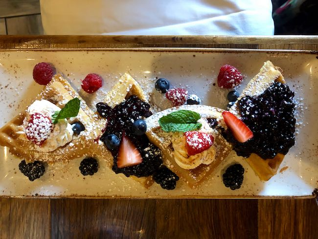 Waffles with Olallieberries. Photo by Claudia Carbone