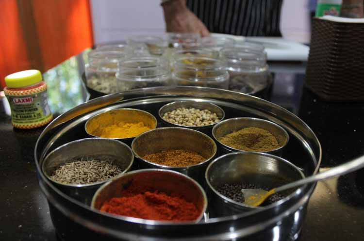 The seven pillars of Indian spices: cumin seeds, chilli powder, mustard seeds, cumin powder, coriander seeds, turmeric powder and garam masala.