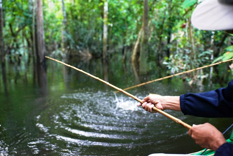 Fishing in the Amazon Requires an Unusual Kind of Fishing Pole. Photo by Amazon Nature Tours