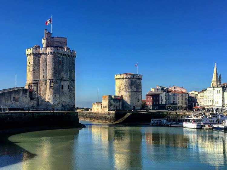 The Tower of Saint-Nicolas and smaller Chain Tower guarding the entrance to La Rochelle's Old Port. Photo by Donald Grant