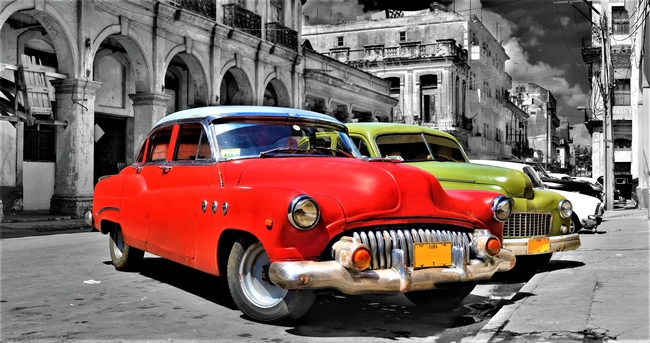 Carefully refurbished American cars add color to the scene in Cuba. Photo by Roxana Gonzalez/Dreamstime.com