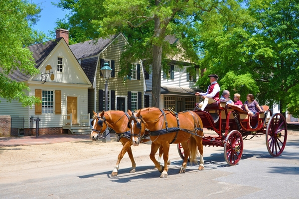 Visitors to Colonial Williamsburg, Virginia enjoy a horse-drawn carriage ride. Photo by Wangkun Jia/Dreasmstime.com