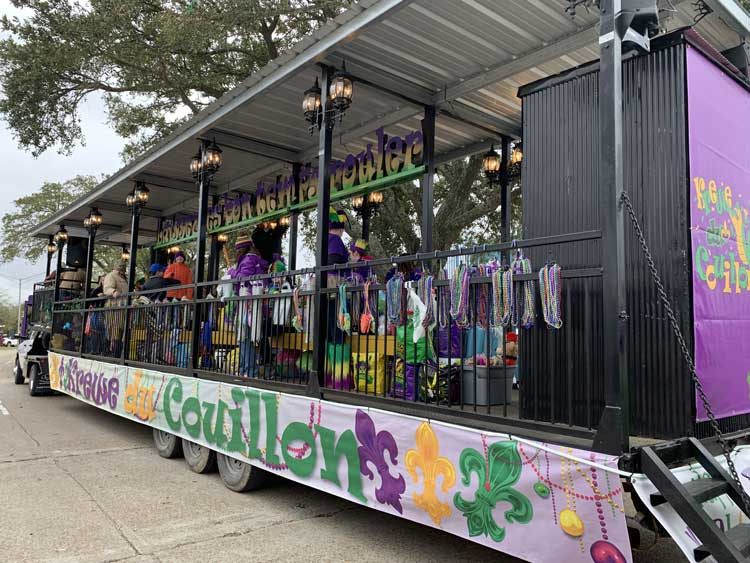 Parade float loaded down with beads to throw. Photo by Janna Graber