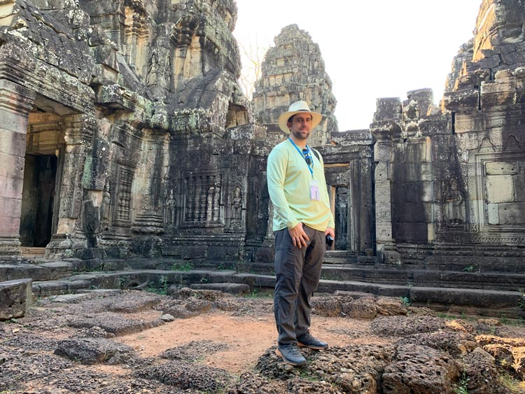 Standing at the temple ruins.