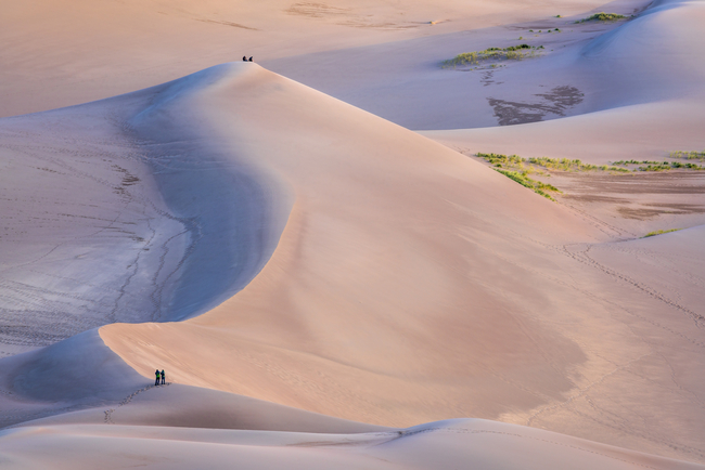 Hikers making their way through Great Sand Dunes National Park. Photo by Marek Uliasz/Dreamstime.com