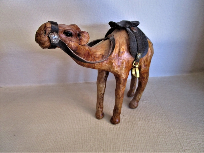 This carved camel is much better tempered than the ornery creature I rode in Tunisia. Photo by Victor Block