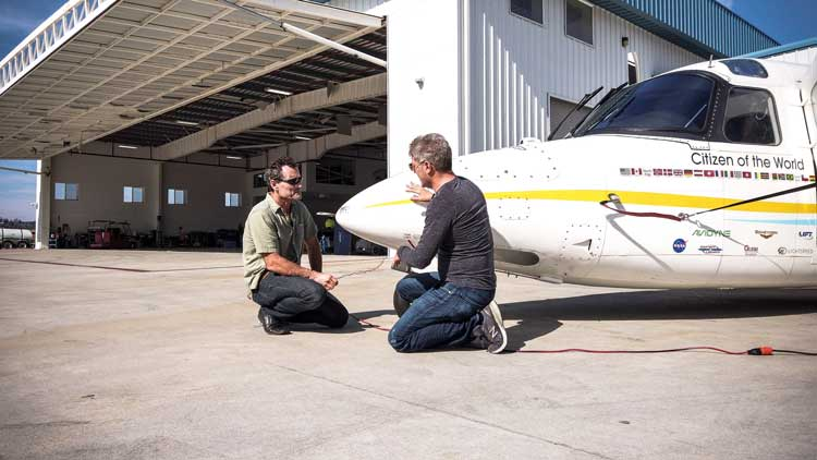 Robert with Dr. Dimitri Deheyn installing the experiment on the plane.