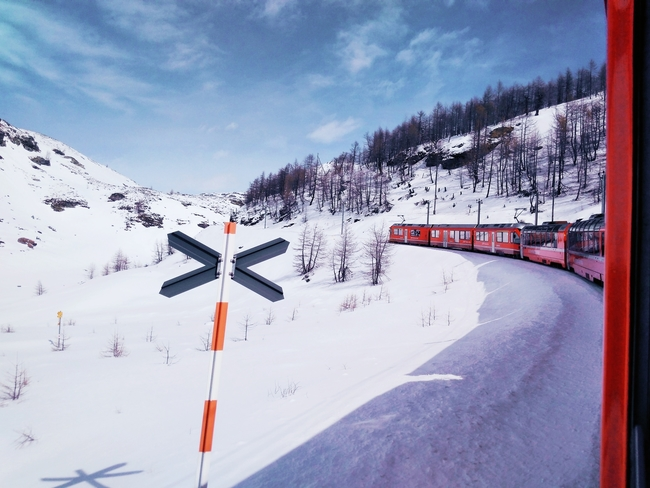 The Glacier Express Traverses a Winter Wonderful in Switzerland. Photo by 13533766401/Dreamstime.com