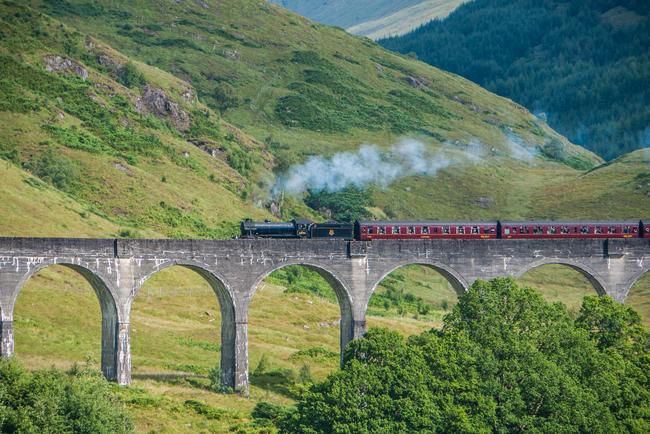 The Jacobite Steam Train Crossing the Glenfinnan Viaduct. Photo by David Gonzalez Rebolio/Dreamstime.com