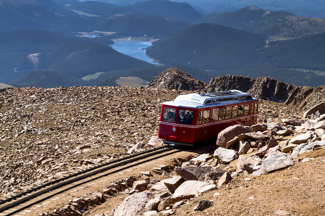 """Passengers Aboard the Pikes Peak Cog Railway Share the View that Inspired """"America the Beautiful"""". Photo by Teri Virbickis/Dreamstime.com"""