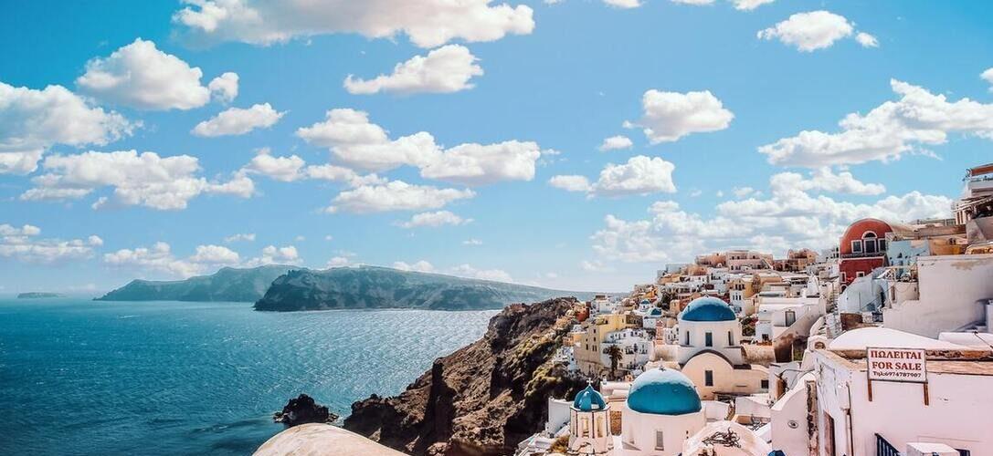 Beautiful view of blue ocean under the sky in Santorini, Greece