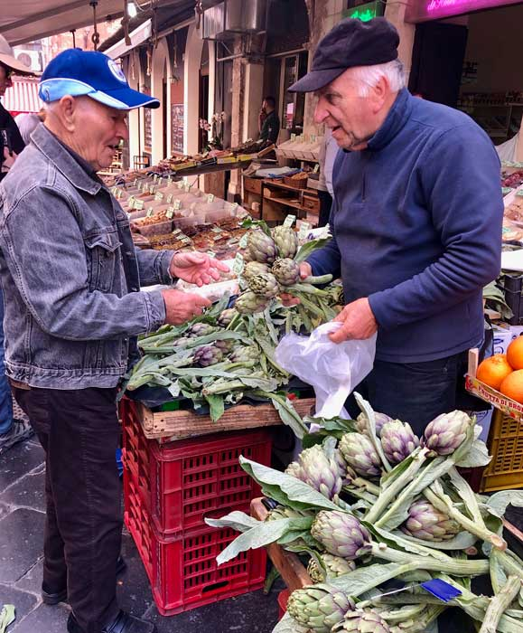 In Sicilian markets you find artichokes sold with the stems still attached. The reason  is that the inside of the stem is an extension of the heart of the artichoke, which is the real meat of the blossom  Photo Credit:  Sharon Kurtz