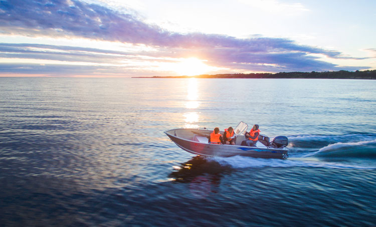 People enjoying a sunset boat ride to see the islands.