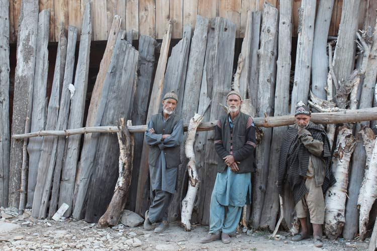 Inhabitants of Sukhnis village pose for a photo. The locals of these remote villages identify with Kashmiris mostly, and would go to the valley to buy groceries and other essentials. It is believed that these communities of sheep and goat herders permanently migrated to this remote place centuries ago to escape the tyrannical Kashmiri non-Muslim rulers. Photo by: Shafat Mir