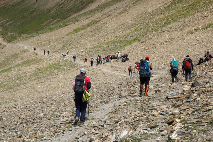 Hikers from different parts of India make an ascent toward Gadsar pass during the Great Lakes Trek in Kashmir.
