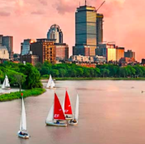 Boats sail along the Charles River in Boston.