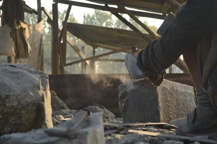 The blow of a stone mason's strike.