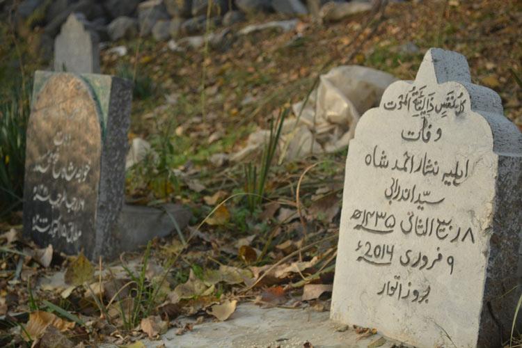 Hand carved epitaphs on tombstones in Kashmir.