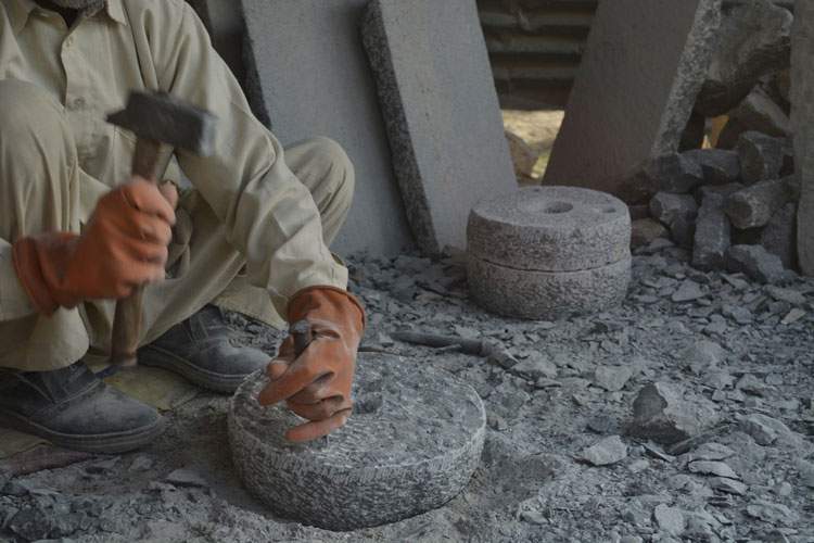 A stone mason's life is a constant grind, working on perfectly carved rings.