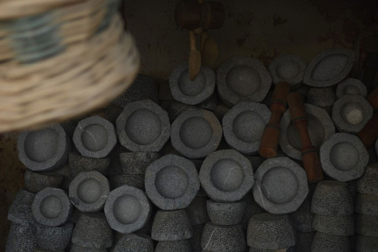 Stacks of stone mortars of all shapes and sizes.