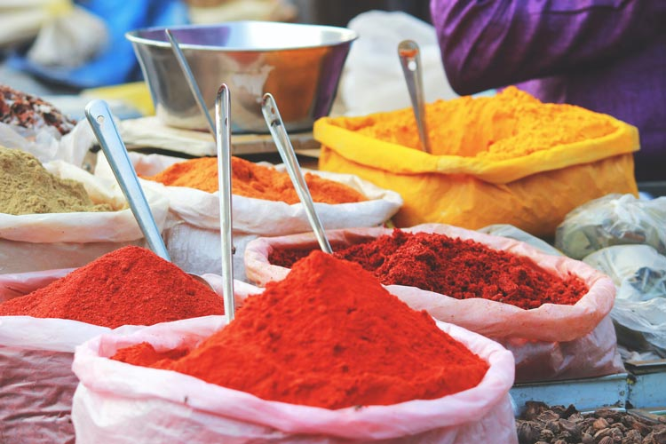 Assortment of color powders used for celebrations in a market in Mapusa, India.