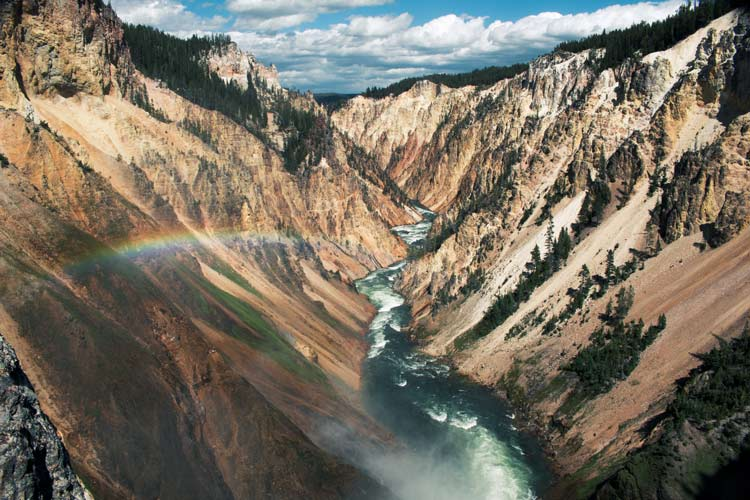 Caught a rainbow over the Yellowstone River rushing through the park crossing three states in the USA.