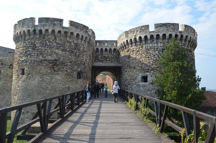 Tourists gather to take photos at one of the arches entering Belgrade Fortress.