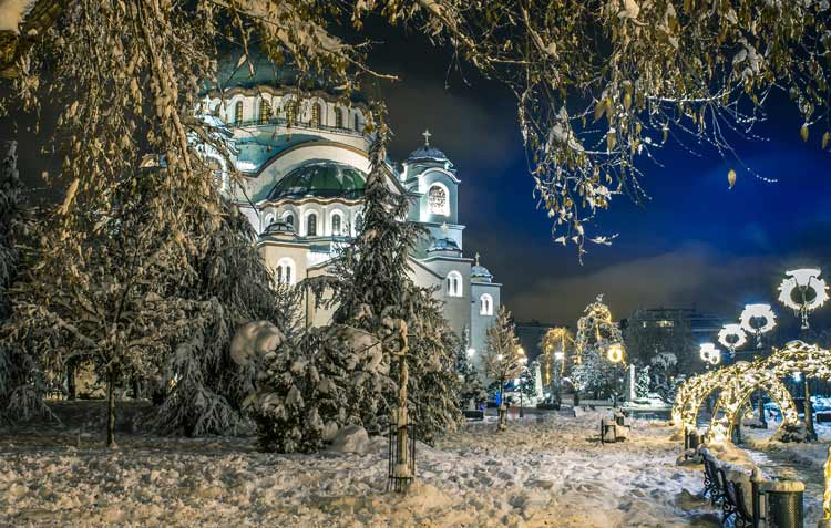 Snow covered Temple of St. Sava during the holidays.
