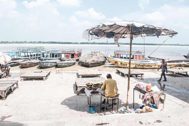 A merchant selling his items along the Ganges River.