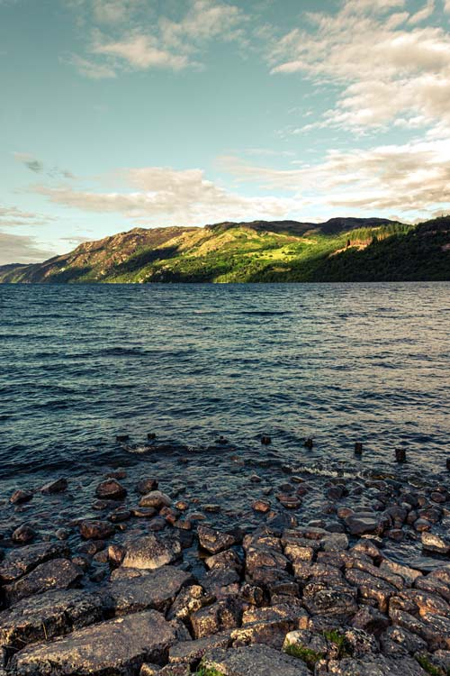 The deep, dark blue water of the Loch Ness Lake.