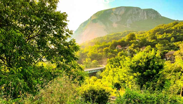 A train riding out to the mountains beyond of Belgrade.