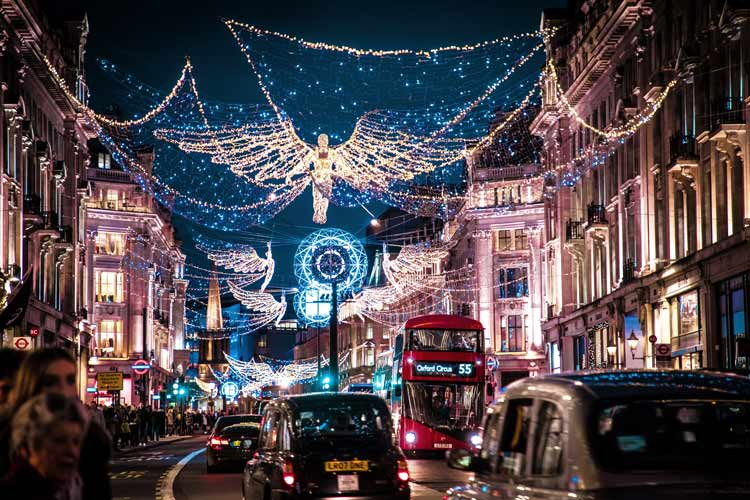 The bustling Regent Street filled with people lights up the night during the holidays.