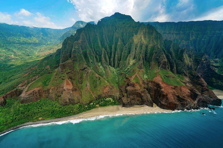 One of the most scenic spots in the United States is the Nā Pali coast on the island of Kauai, Hawaii.