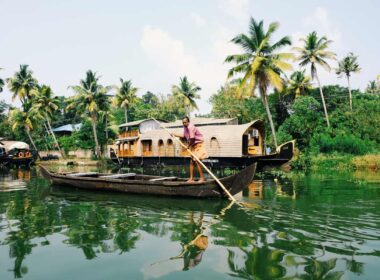 A man boating on the backwaters of the Kerala river in India
